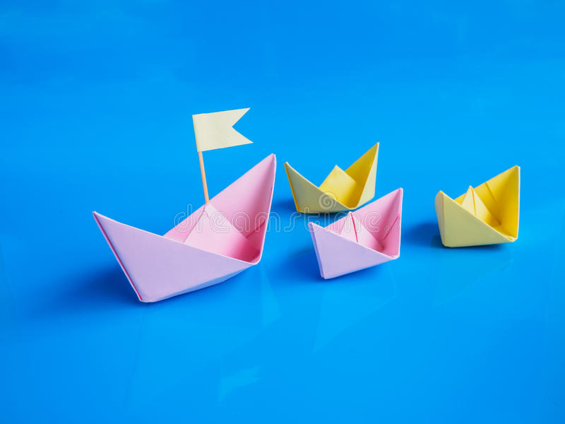 Leadership and team work concept, Craft of paper boat group Or royalty free stock photography