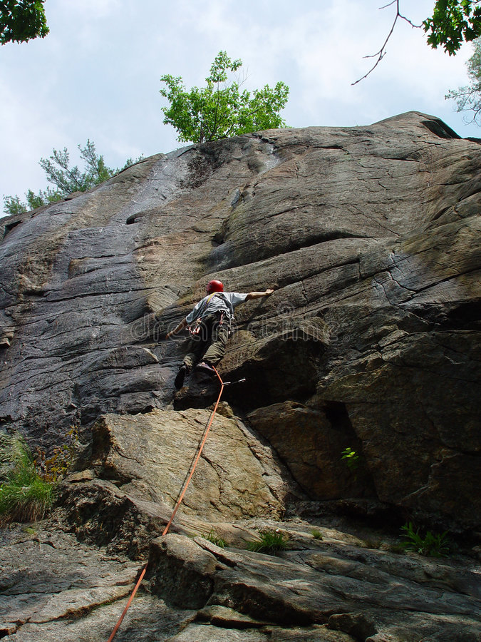 Leading the rock climb stock images