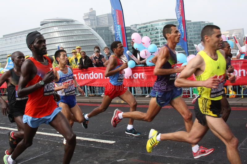 Leading runners in London marathon 2010. A group of male runners passing Tower bridge at London marathon 2010 royalty free stock image