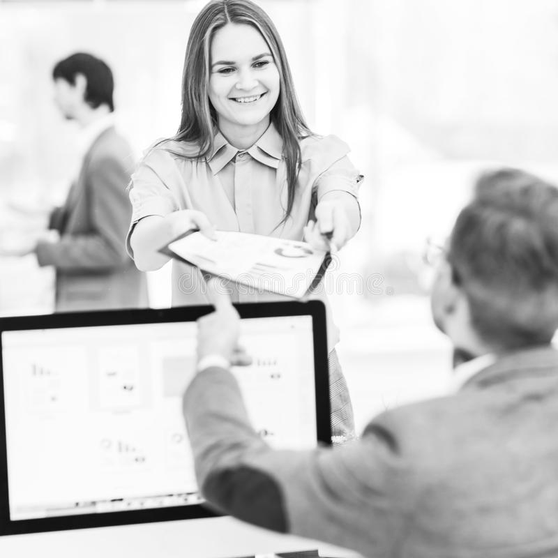 leading specialist of Finance and Manager of the company working with financial charts in the company`s profit stock image