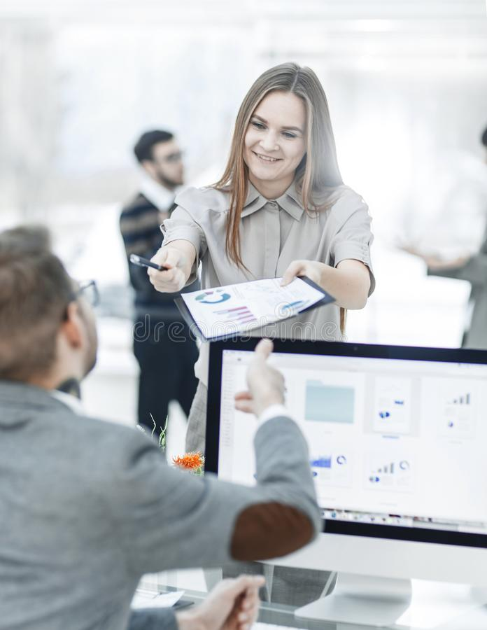 leading specialist of Finance and Manager of the company working with financial charts in the company`s profit royalty free stock image