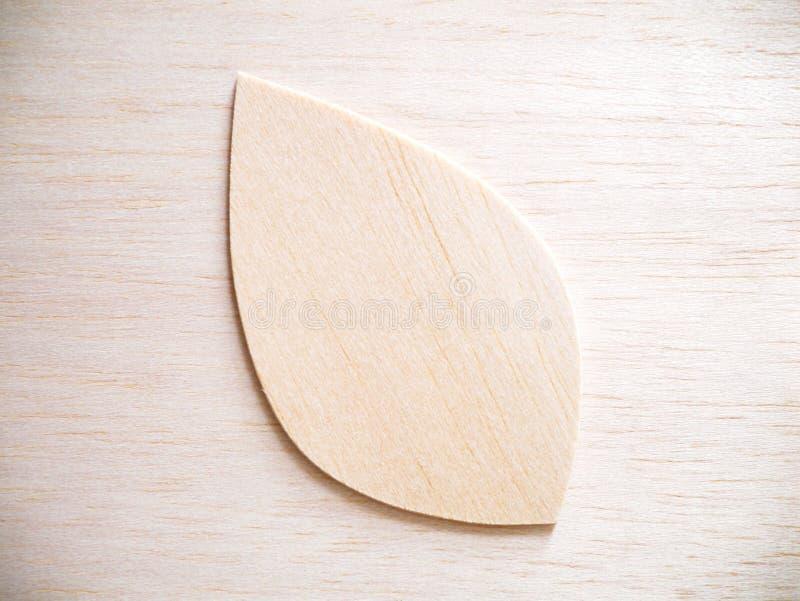 Leaf symbol logo concept, wood cutting design illustration icon. Sign stock photo