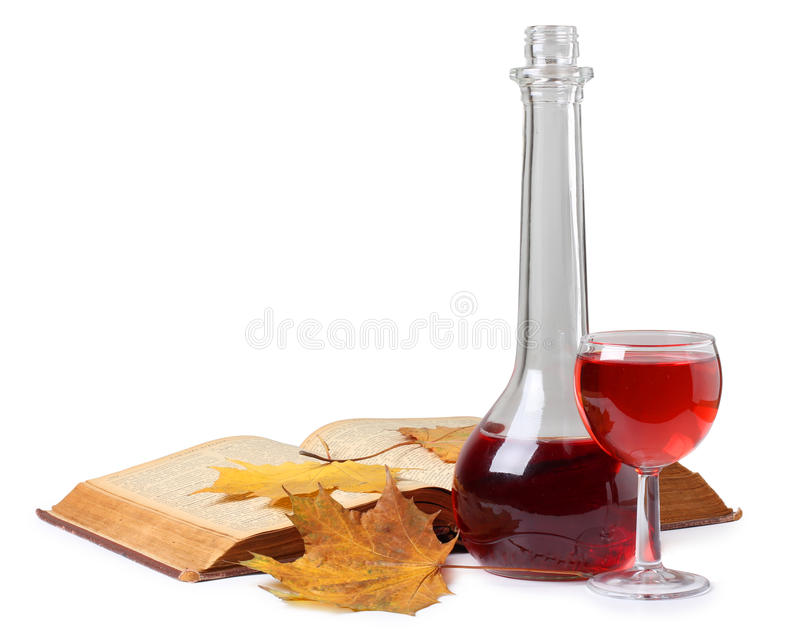 Leaf and wine. Color photo of a glass of wine and book stock photography