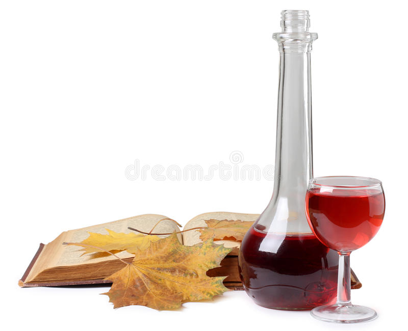 Leaf and wineglasse. Color photo of a glass of wine and book royalty free stock images