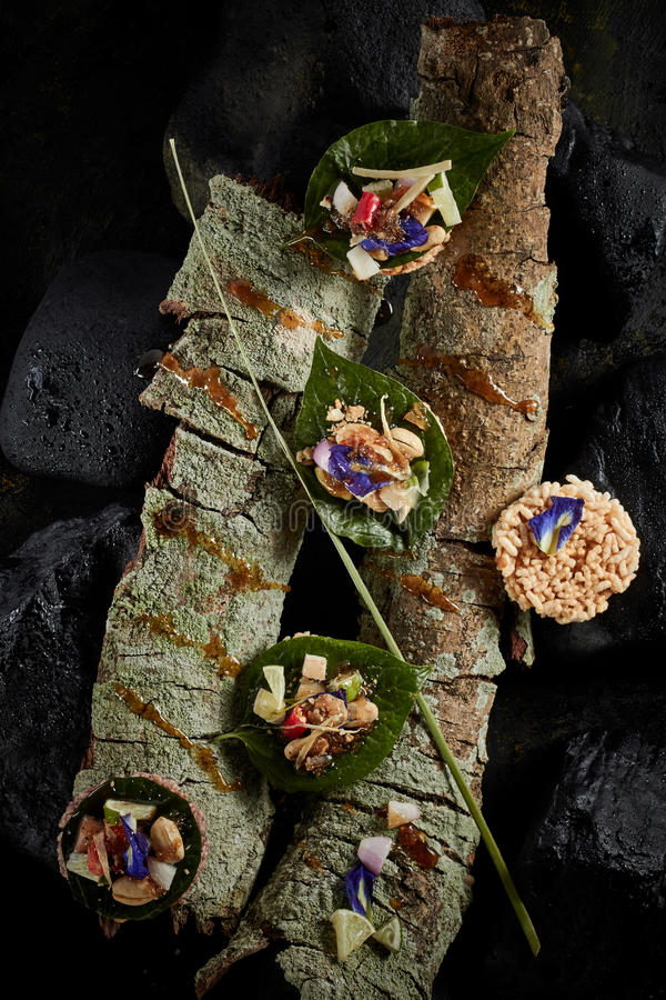 Leaf-Wrapped Bite-Size Appetizer. stock image