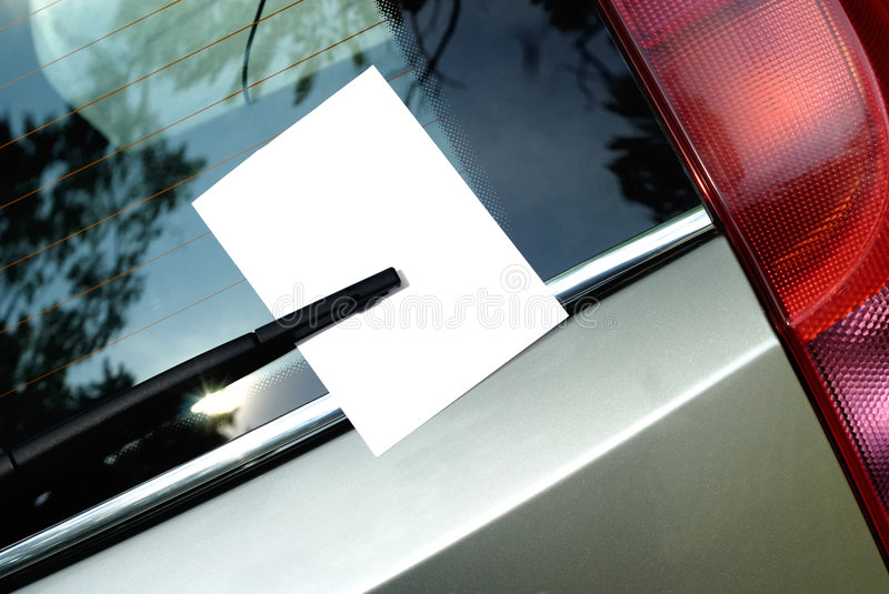 Leaflet behind car wiper royalty free stock photos