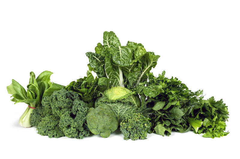 Leafy Green Vegetables Isolated. Variety of leafy green vegetables isolated on white background royalty free stock photography