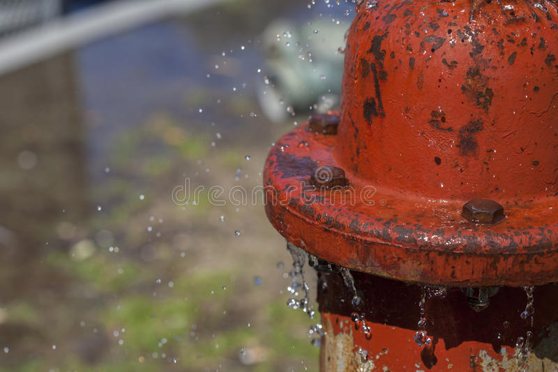 Leaking Fire Hydrant Spraying Water. Close up background stock photo