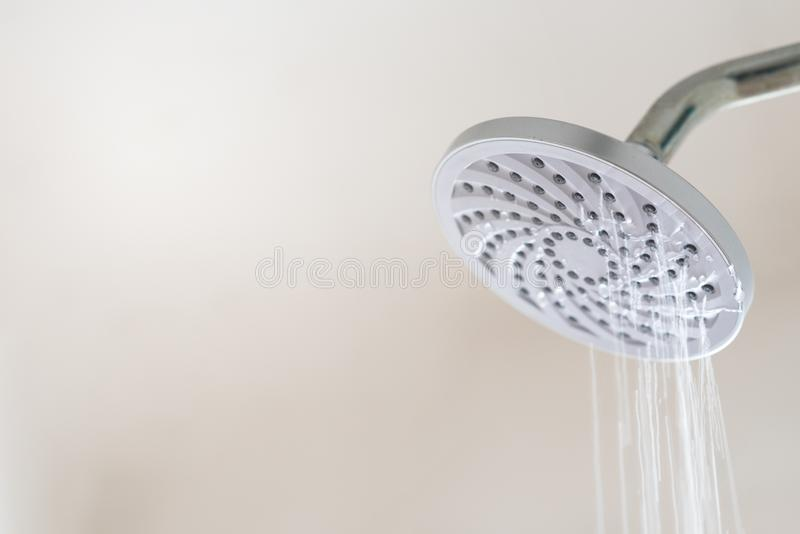 Leaking water from a shower head. Concept of water wastage royalty free stock images