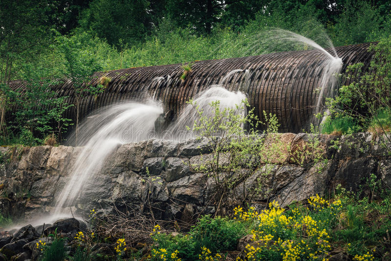 Leaking water tube. Made of wood, leading to a hydro electric power plant stock image