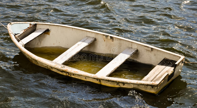 Leaky life boat stock photography
