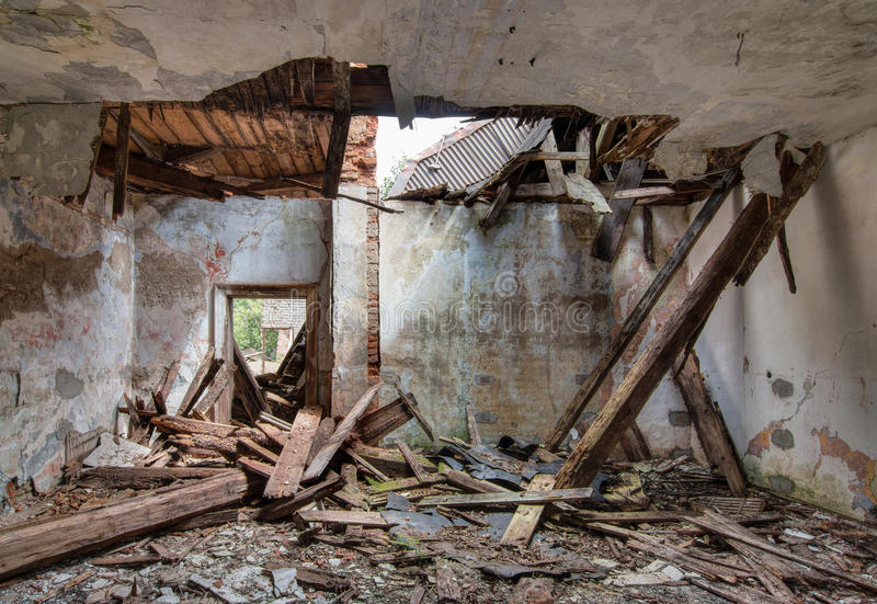 Leaky roof - interior of the old, abandoned and crumbling building stock photography