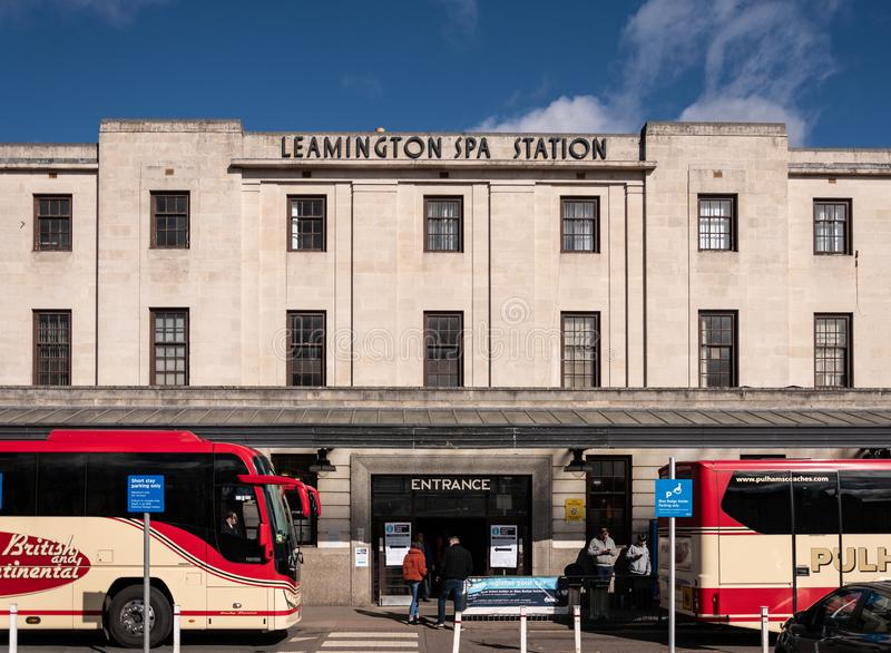 Leamington Spa Station entrance. Royal Leamington Spa, United Kingdom - March 17 2019:   Two coaches parked outside the entrance to Leamington Spa railway stock photos