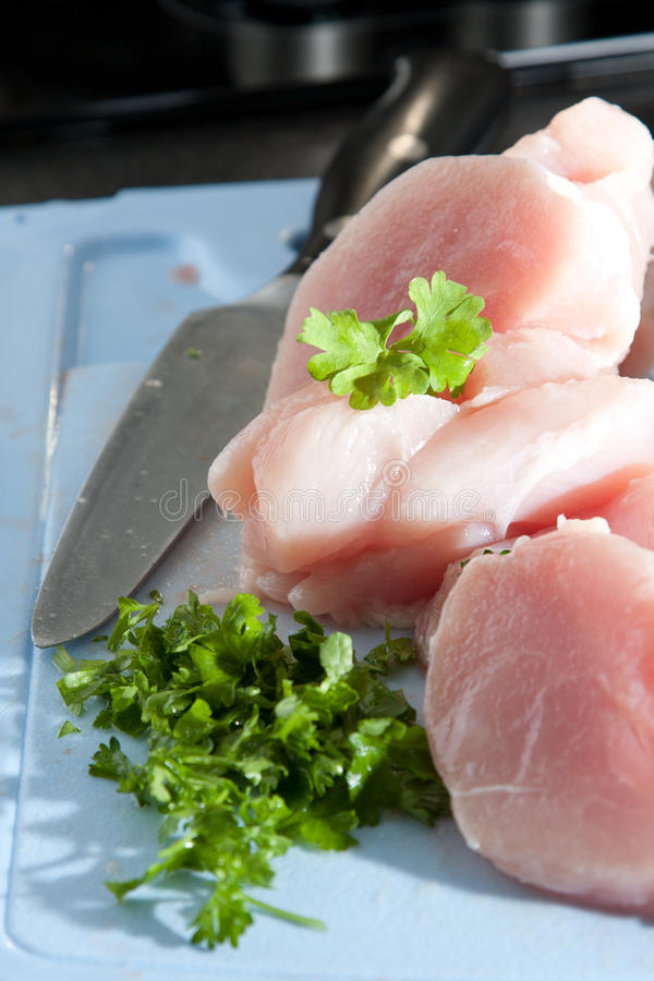 Download Lean Chicken Pieces With Chopped Parsley Stock Photo - Image: 25052362