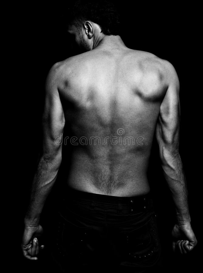 Lean fit man with muscular back stock photos