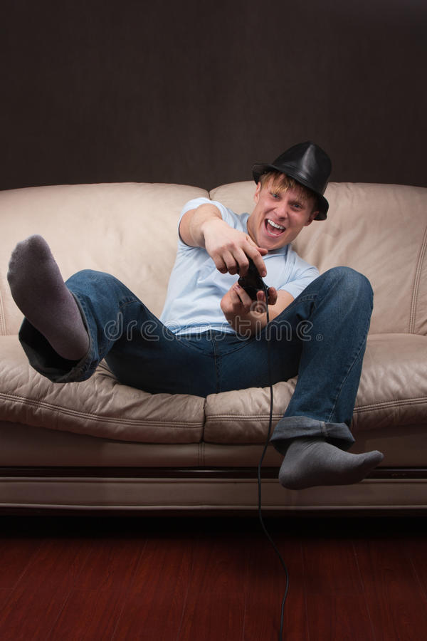 Download Leaning gamer stock photo. Image of console, legs, hand - 18964846