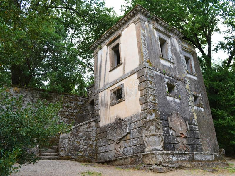 Leaning house. In Parco dei Mostri (Park of the Monsters), in Bomarzo (Viterbo, Italy). The gardens are a Manieristic monumental complex created during the 16th royalty free stock photos