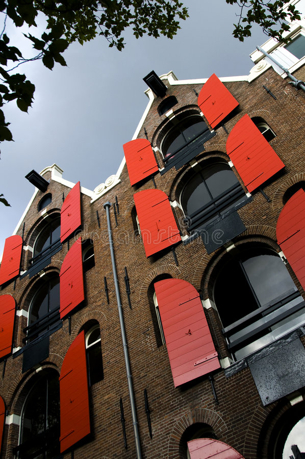 Leaning houses with hoist lifts amsterdam royalty free stock image