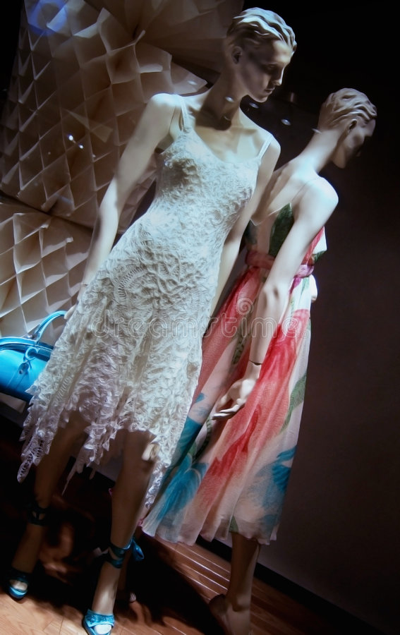 Leaning Towards Fashion. Stylish mannequins posed in cocktail dresses royalty free stock images