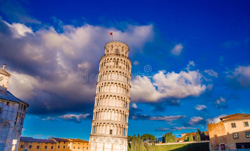 Leaning Tower of Pisa. Building is part architectural complex Cathedral and bell. Bright blue sky with white clouds, Sunny day royalty free stock photo