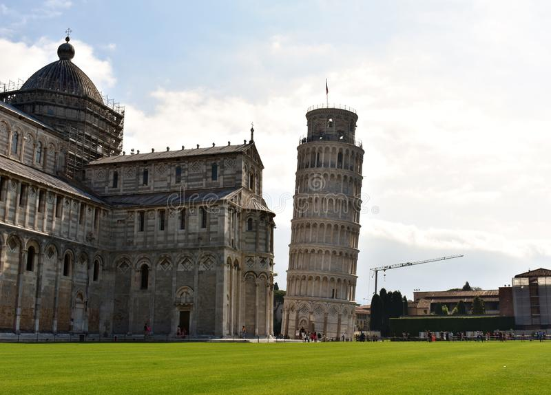 The Leaning Tower of Pisa @ Italy. It is the campanile or freestanding bell tower of the Cathedral of Pisa, Italy. Started in 1173 and completed in 1372. It is stock photos