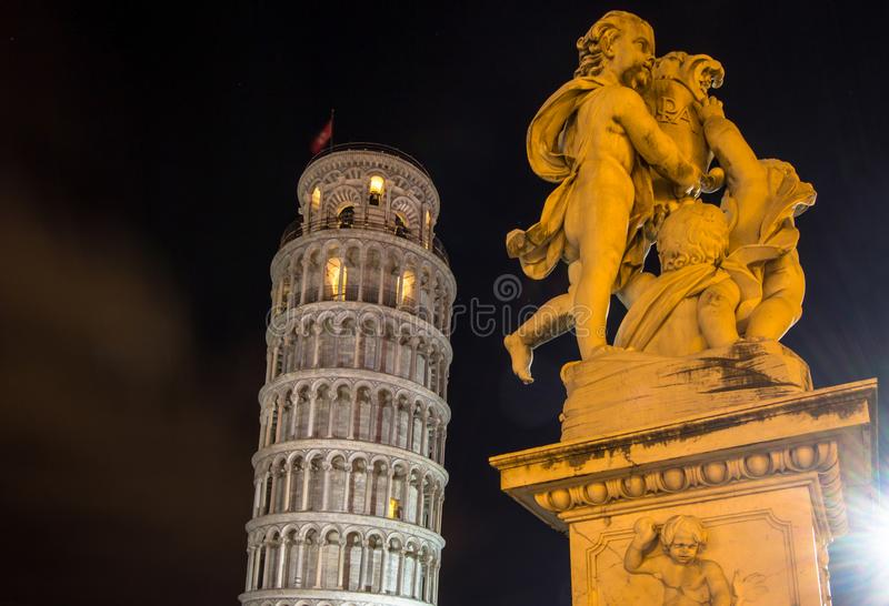 The Leaning Tower of Pisa and the Fontana dei Putti Fountain wi. The Belltower of Pisa, a wonderful medieval monument, one of the most famous landmark in Italy royalty free stock images