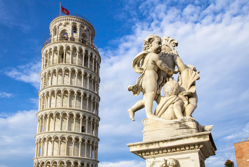 Leaning Tower of Pisa and the Fontana dei Putti, Italy. The Belltower of Pisa, and wonderful medieval monument - the Fontana dei Putti Fountain with Angels with stock photos