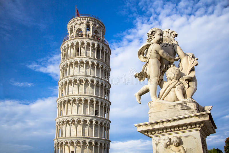 Leaning Tower of Pisa and the Fontana dei Putti, Italy. The Belltower of Pisa, and wonderful medieval monument - the Fontana dei Putti Fountain with Angels with royalty free stock image