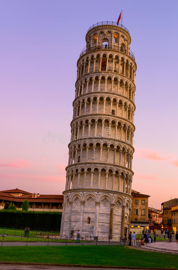 The Leaning Tower of Pisa (Torre pendente di Pisa) at sunset in Pisa, Italy stock photos
