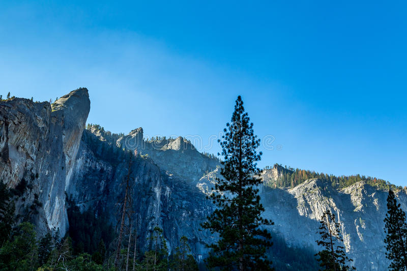 Leaning Tower. The Leaning Tower in Yosemite National Park is a popular destination for rock climbers. It is located west of, and adjacent to Bridalveil Fall, on stock image