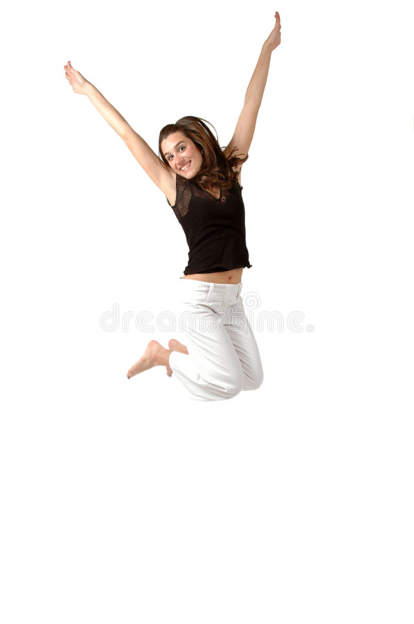 Leap. Happy woman leaps in the air with her arms in Victory position stock photo