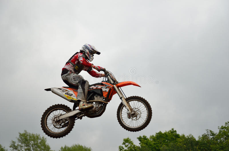 A leap over the hill motocross racer royalty free stock images