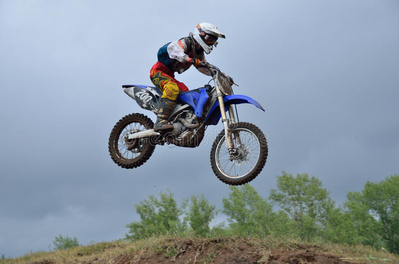 A leap over the hill motocross racer royalty free stock photography