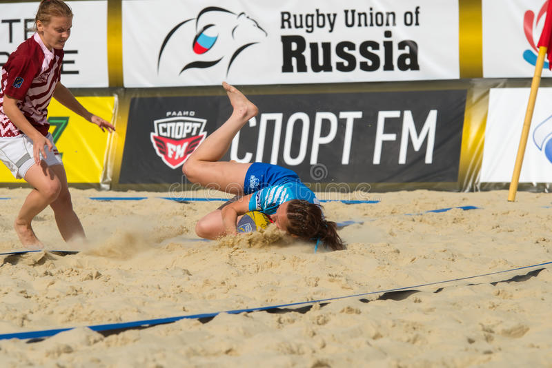 Leap into the sand. MOSCOW, RUSSIA - JULY 22-23, 2017: Rugby players in action at the on European Beach Fives Rugby Championship 2017 in the match Russia blue vs royalty free stock images