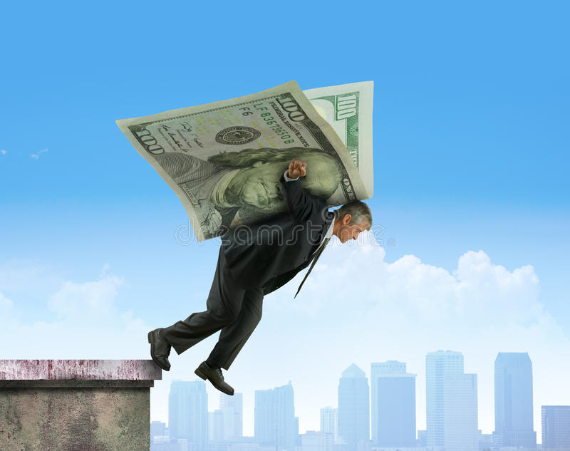 Leaping off building on wings of money financial investments success stock images