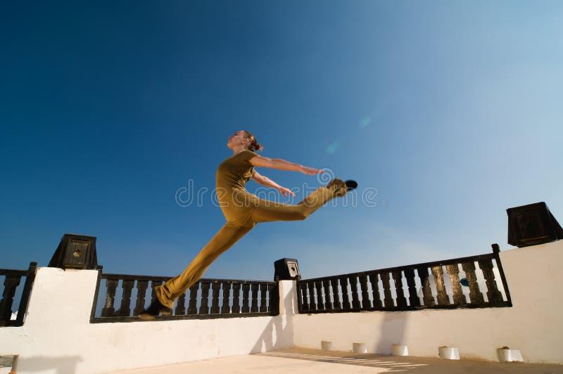 Leaping yoga dancer stock photo
