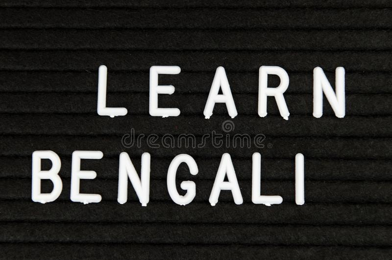 Learn Bengali language, simple sign on black background, great for teachers, schools, students. Learn language sign on black background royalty free stock photo