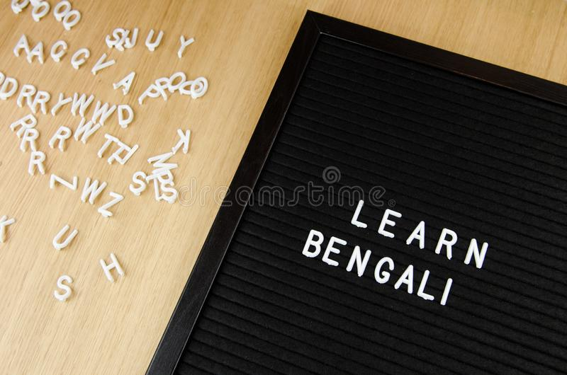 Learn Bengali language, simple sign on black background, great for teachers, schools, students. Learn language sign on black background stock image