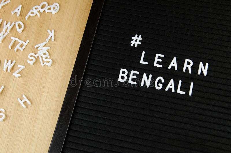 Learn Bengali language, simple sign on black background, great for teachers, schools, students. Learn language sign on black background stock photo