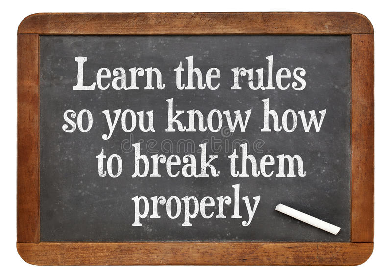 Learn and break rules. Learn the rules, so you know hot to break them properly. INspirational words on a vintage slate blackboard royalty free stock photography