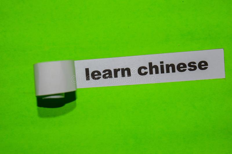 Learn Chinese, education concept on green torn paper stock photos