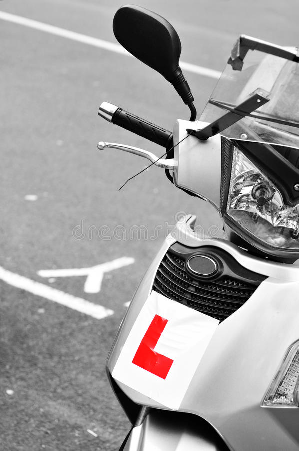 Learn driving. Plate on scooter royalty free stock photos