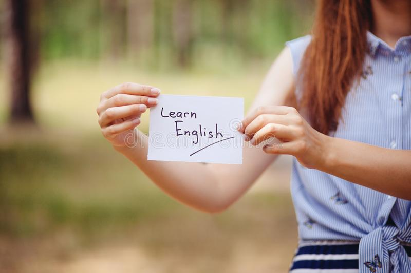 Learn English - woman with text on card, education and studying language stock image