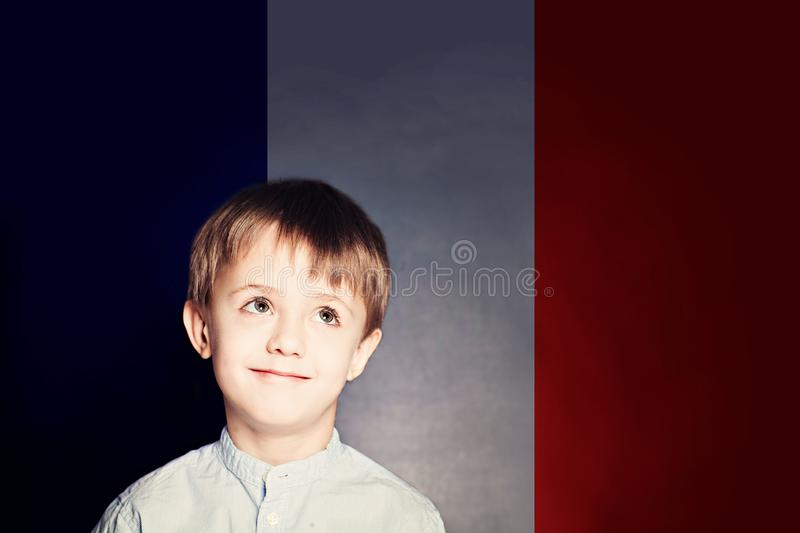 Learn french language concept. Happy child student with flag stock photos