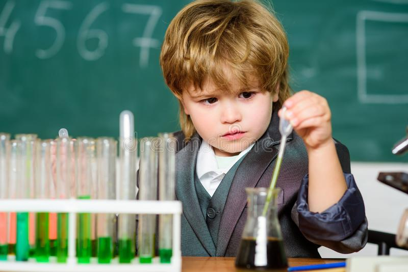Learn for future. Biology science. testing tubes with liquid for research. small boy study chemistry. result. Medical stock photos