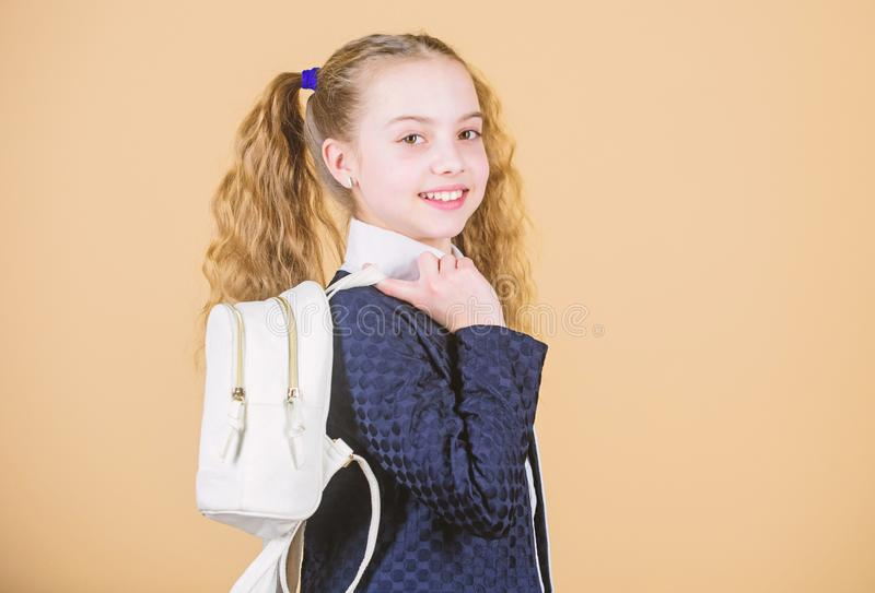 Learn how fit backpack correctly. Girl little fashionable cutie carry backpack. Popular useful fashion accessory. Schoolgirl ponytails hairstyle with small stock photo