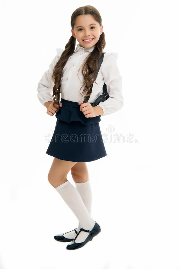 Learn how fit backpack correctly for school. Schoolgirl cute in formal uniform wear backpack. School backpack concept stock photo