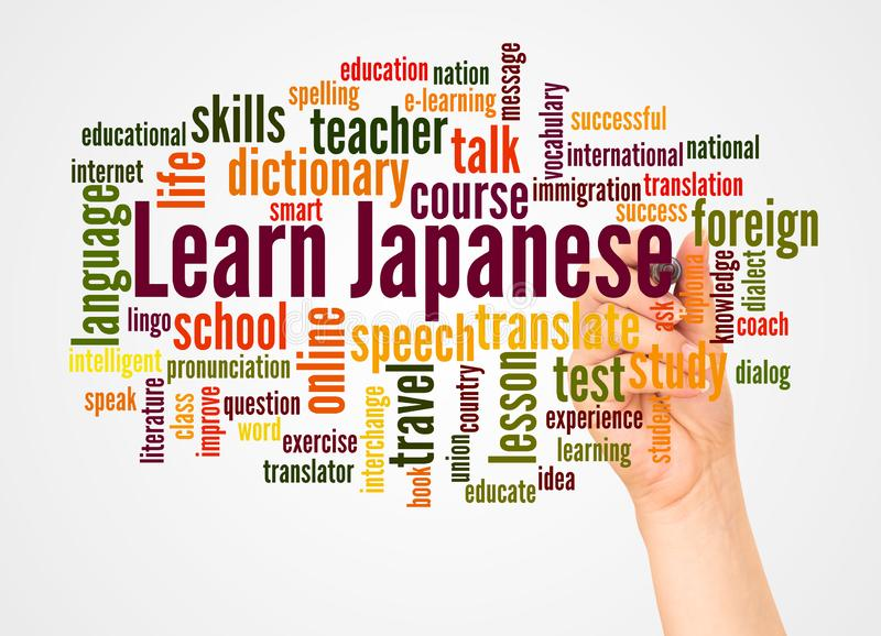 Learn Japanese word cloud and hand with marker concept stock photography