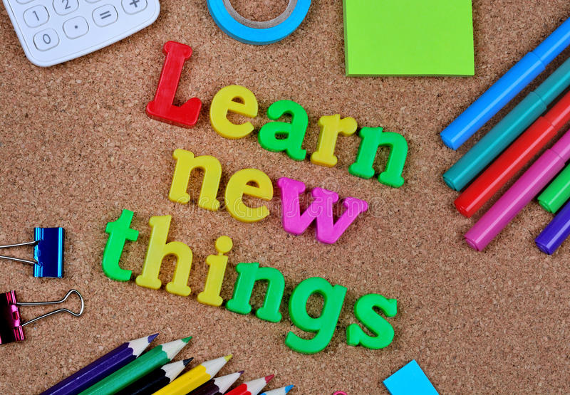 Learn new things words. On cork background royalty free stock photography