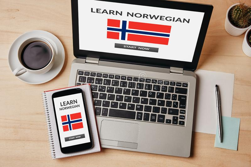Learn Norwegian concept on laptop and smartphone screen royalty free stock photography